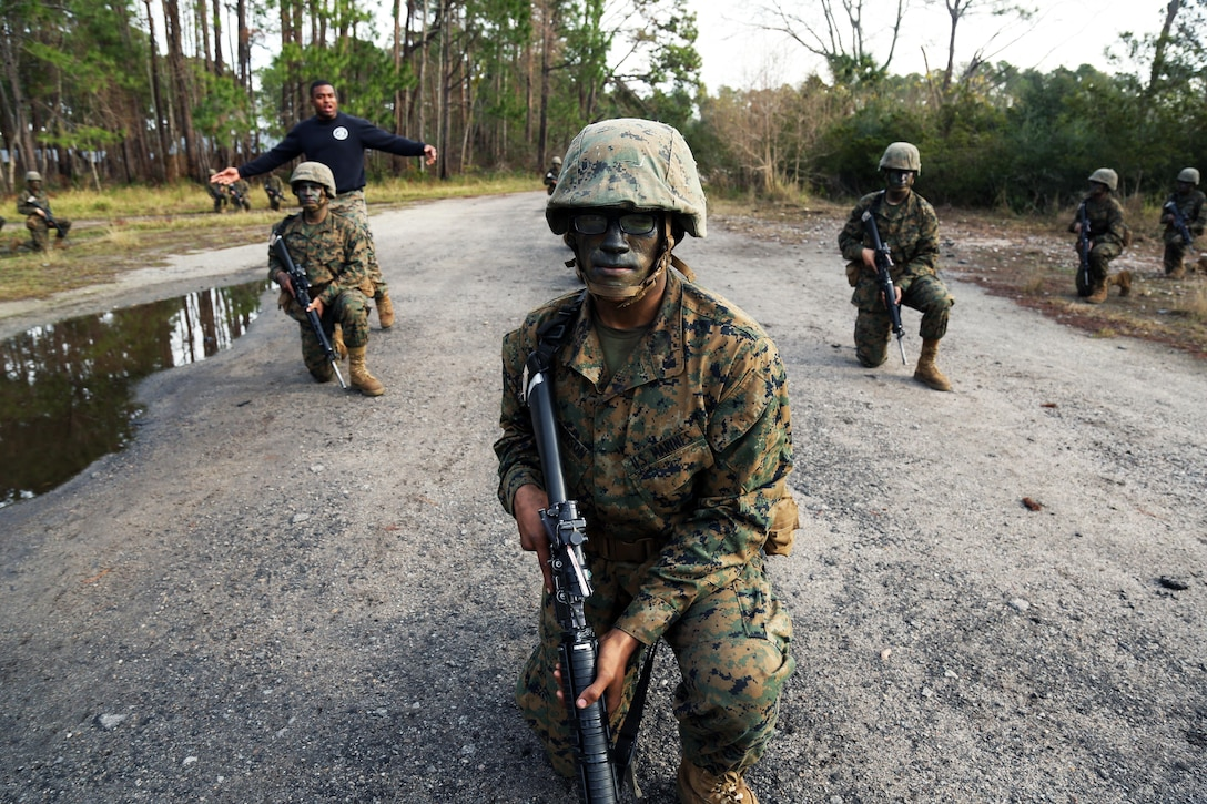 Marine Corps recruit Donovan Davidson practices hand and arm signals during Basic Warrior Training at Paige Field on Marine Corps Recruit Depot, Parris Island, S.C., Jan. 4, 2017. Basic Warrior Training is a 48 hour training evolution that covers land navigation, improvised explosive devices and fire and movement. Marine Corps photo by Lance Cpl. Sarah Stegall