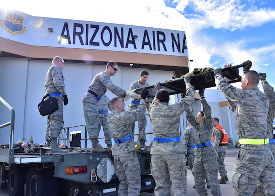 Airmen from the 944th Aeromedical Staging Squadron work together to load a simulated patient onto a K-loader Jan. 7 during a joint patient movement training exercise at Goldwater Air National Guard Base, Ariz. (U.S. Air Force photo by Tech. Sgt. Louis Vega Jr.)