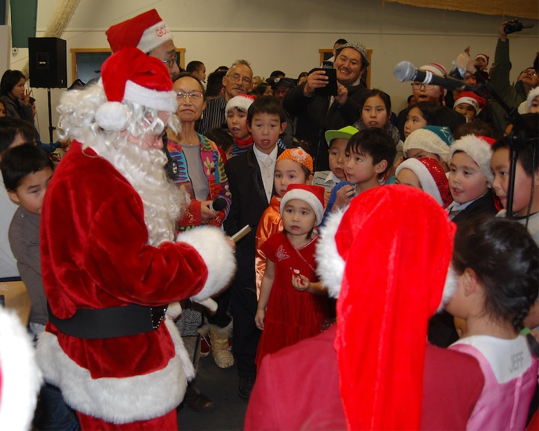 QAANAAQ, Greenland – Santa Claus and 821st Air Base Group leadership at Thule Air Base, Greenland, talk with local children and hand out goodies during Operation Julemond in the local community of Qaanaq, Dec. 22, 2016. Village families gather every year to celebrate the international relationship with songs around the Christmas tree, hugs, laughter and gifts. (U.S. Air Force photo by Tech. Sgt. Shawn Joseph)