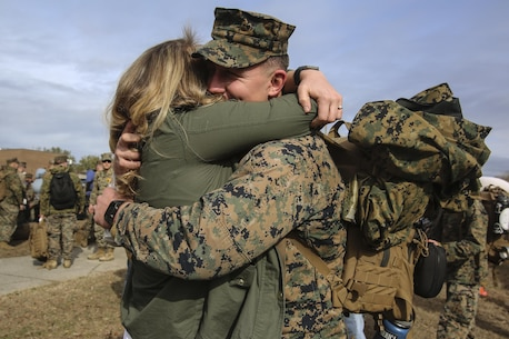 A Marine embraces a loved one during Special Purpose Marine Air-Ground Task Force Crisis Response-Africa's homecoming at Camp Lejeune, N.C., Jan. 10, 2017. After completing the mission of protecting U.S. personnel, property and interests in Europe and Africa, Marines returned home safely from their nine-month deployment. The Marines and sailors returning are with Combat Logistic Battalion 2 (U.S. Marine Corps photo by Lance Cpl. Miranda Faughn)