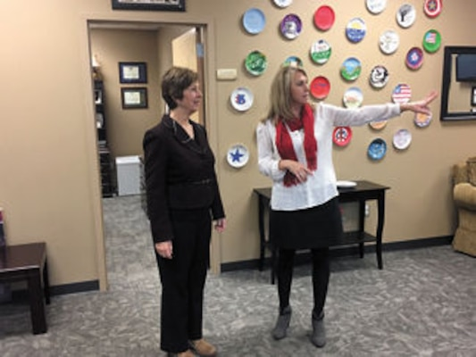 Mrs. Laura Hyten (left), wife of U.S. Strategic Command commander Gen. John Hyten, toured Army Community Services at Redstone Arsenal with Survivor Outreach Services coordinator Kerrie Branson to learn about the resources available to assist military families.