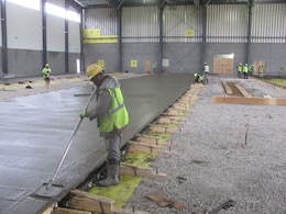 Workers on the newly unveiled Unmanned Aerial Systems hangar constructed at Camp Mackall near Fort Bragg, North Carolina. The facility, built by Caddell Construction, won the state and national-level Associated Builders and Constractors, Inc. Excellence in Construction Competition in December 2016. It also received state-level honors from the Associated General Contractors of America.