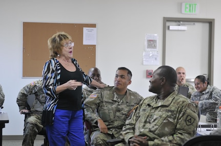 Margaret 'Meg' Haycraft (left), director of psychological health, 63rd Regional Support Command, jokes with U.S. Army Reserve Soldiers at a Sexual Harassment/Assault Response and Prevention class, Nov. 9, 2016, Camp Parks, Dublin, Calif. Haycraft helps Reserve Soldiers in mental health distress and aids them on the path to recovery through various means.  (U.S. Army Reserve photo by Sgt. 1st Class LaTonya Kelly)