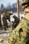 Marines with Weapons Company, 3rd Battalion, 25th Marine Regiment, 4th Marine Division, prepare a fence charge during exercise Nordic Frost at Camp Ethan Allen Training Site in Jericho, Vt., Jan. 7. 2017. The Marines were evaluated on their ability to successfully operate demolitions in a demanding cold-weather environment. (U.S. Marine Corps photo by Cpl. Melissa Martens/ Released)