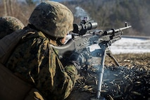 Lance Cpl. Jordan T. Woodard, machine gunner for Company I, 3rd Battalion, 25th Marine Regiment, 4th Marine Division, fires the M240 machine gun during exercise Nordic Frost at Camp Ethan Allen Training Site in Jericho, Vt., Jan. 7. 2017. Throughout the exercise, Marines conduct training in a demanding cold-weather environment that places an emphasis on small-unit leadership. (U.S. Marine Corps photo by Cpl. Melissa Martens/ Released)