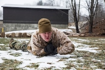 Lance Cpl. Joshua D, Burson, ground radio repair-man, Headquarters and Service Company, 3rd Battalion, 25th Marine Regiment, 4th Marine Division, low crawls during a Marine Corps Martial Arts Program course while at exercise Nordic Frost at Camp Ethan Allen Training Site in Jericho, Vt., Jan. 8. 2017. Marines were provided the opportunity to obtain their grey or green belts during the exercise. (U.S. Marine Corps photo by Cpl. Melissa Martens/ Released)