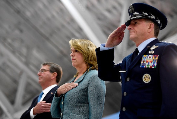 Secretary of the Air Force Deborah Lee James stands for the national anthem with Air Force Chief of Staff Gen. David L. Goldfein and Secretary of Defense Ash Carter, during her farewell ceremony at Joint Base Andrews, Md., Jan. 11, 2017.  James took office as the 23rd secretary of the Air Force in December 2013. (U.S. Air Force photo/Scott M. Ash)