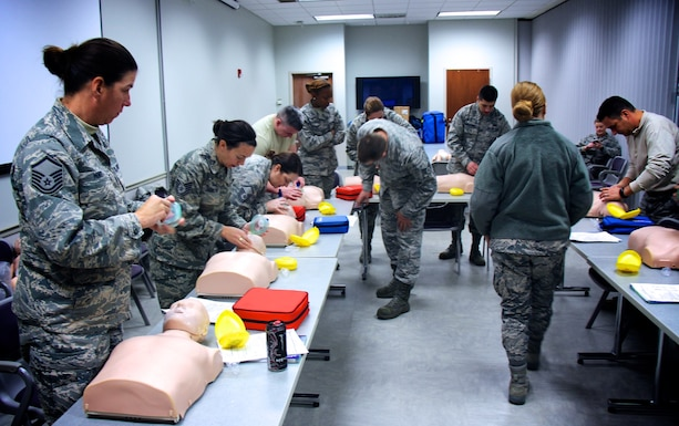 Airmen of the 932nd Airlift Wing helped each other train during the January Unit Training Assembly. Basic life saving skills (BLS) were taught methodically, step by step, with instructors watching during annual Emergency Medical Technician training, inside the 932nd Medical Group. This included proper procedures for patient assessment and trauma treatment in a special class held January 7, 2017, at Scott Air Force Base, Ill. The 932nd Medical Group is one of four groups under the 932nd Airlift Wing, a 22nd Air Force unit and part of Air Force Reserve Command.(U.S. Air Force photo by Lt. Col. Stan Paregien)