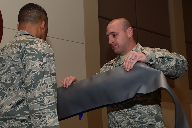 Lt. Col. Craig Thorstenson, 460th Operations Group, Detachment 1 commander, covers a rolled guidon flag, which symbolizes the closure of the detachment, during the 460th OG Det. 1 deactivation ceremony Jan. 11, 2017, at the Leadership Development Center on Buckley Air Force Base, Colo. The official inactivation of Det. 1 will be on Jan. 31, 2017. (U.S. Air Force photo by Airman 1st Class Gabrielle Spradling/Released)