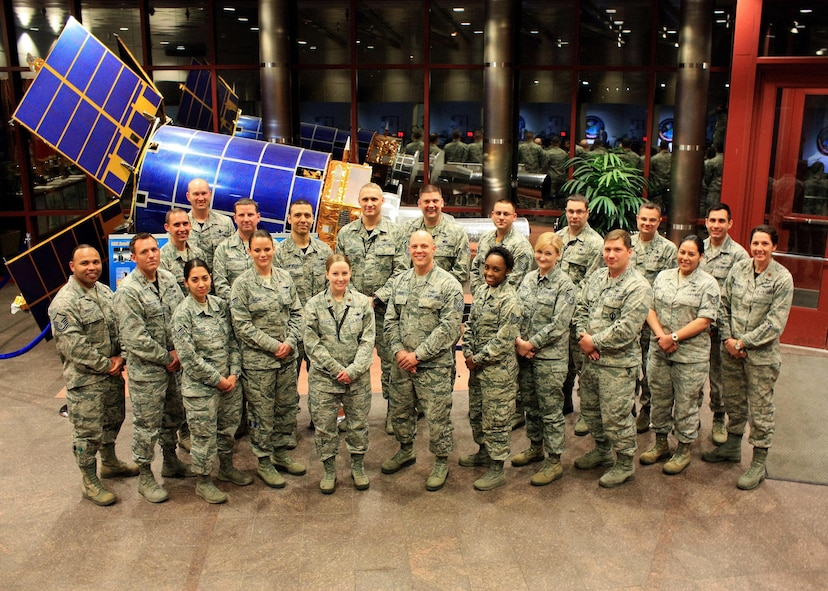 Total Force Airmen, left to right, front to back, Master Sgt. Eric Morales, Maj. David Usilton, Senior Airman Cheryl Ellison, Senior Airman Alexa Gerard, Maj. Sarah Ford, Master Sgt. John Fairman, Staff Sgt. Kayla Meeks, Master Sgt. Alexandra Goodwin, Maj. Jonathan Shycko, Staff Sgt. Casandra Cabral, Maj. Heather Swanson, Staff Sgt. Andrew Calvin, Master Sgt. Kevin Reed, Ronnie Harville, Tech. Sgt. Angel Santaella III, Master Sgt. Gregory Dolak, Tech. Sgt. Ryan Eanes, Senior Master Sgt. Joshua Savitt, Master Sgt. Ryan Kegebein, Master Sgt. Michael Taylor, Senior Airman Romo Miguel Jr., from the 8th Space Warning Squadron pose for a photo at the mission control station Jan. 7, 2016, on Buckley Air Force Base, Colo. For the first time in over 14 years, the 8th Space Warning Squadron and their sister squadron Detachment 1, 8th Space Warning Squadron provided a full reservist crew to man the Space-Based Missile Warning System. (Courtesy photo)