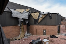 PETERSON AIR FORCE BASE, Colo. – The entire roof of a hangar next to the flightline lifted off the structure and blew over the rest of the building during a wind storm Jan. 9, 2017. Damage to the natural gas lines caused officials to restrict movement in the area to keep the personnel safe. (U.S. Air Force photo by Senior Airman Rose Gudex)