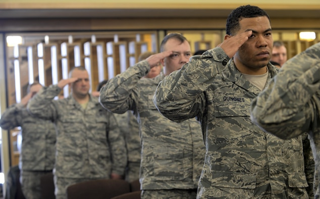 Airmen salute as Taps plays during Master Sgt. Scott W. Scovell's memorial service inside the Freedom Chapel at Ellsworth Air Force Base, S.D., Jan. 11, 2017. Scovell passed away Jan. 3, and is survived by his wife and two children. (U.S. Air Force photo by Airman 1st Class Denise M. Jenson)