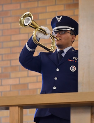 A member of Ellsworth's Honor Guard performs Taps during Master Sgt. Scott W. Scovell's memorial service inside the Freedom Chapel at Ellsworth Air Force Base, S.D., Jan. 11, 2017. Scovell passed away Jan. 3, and is survived by his wife and two children. (U.S. Air Force photo by Airman 1st Class Randahl J. Jenson)