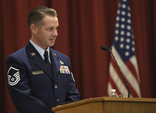 Master Sgt. Kenneth McKenna, the chief inspector of quality assurance assigned to the 352nd Special Operations Maintenance Group at Royal Air Force Mildenhall, England and a friend of Master Sgt. Scott W. Scovell, speaks at Scovell's memorial service inside the Freedom Chapel at Ellsworth Air Force Base, S.D., Jan. 11, 2017. McKenna met Scovell, who passed away Jan. 3, when they served together at Elmendorf Air Force Base, Alaska, in 2005, and remained friends throughout many moves and duty assignments. (U.S. Air Force photo by Airman 1st Class Randahl J. Jenson)