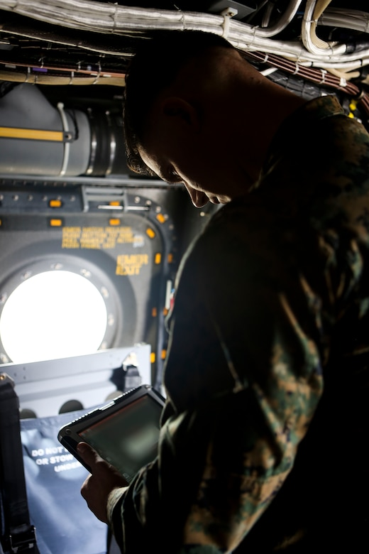 A Marine with 3rd Marine Aircraft Wing sets up the Hatch Mounted SATCOM (Satellite Communication) Antenna System (HMSAS) in preparation of the demonstration for the 3rd MAW commanding general aboard Marine Corps Air Station Miramar, Calif., Jan. 9. The HMSAS was developed for pre-deployment training in order to enhance communications for raid force and tactical recovery of aircraft and personnel (TRAP) missions, in preparation to support a Special Purpose Marine Air-Ground Task Force (SPMAGTF).