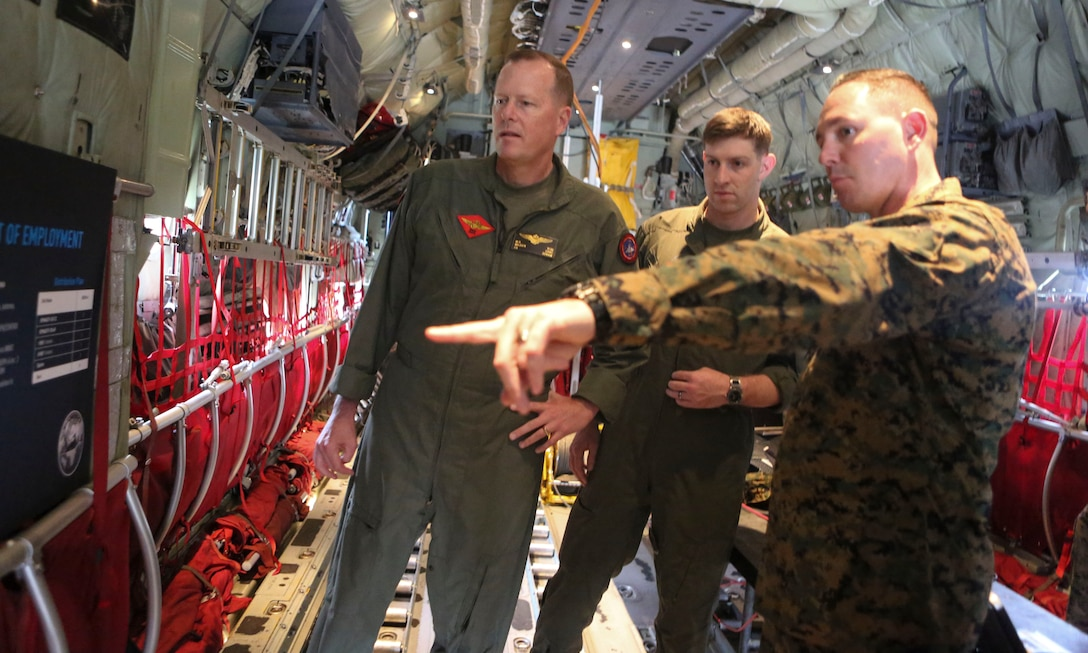 Master Sgt. Michael A. Moore, 3rd Marine Aircraft Wing G-6, technical control engineer, explains future plans for the Hatch Mounted SATCOM (Satellite Communication) Antenna System (HMSAS) to the commanding general of 3rd MAW, Maj. Gen. Mark Wise aboard Marine Corps Air Station Miramar, Calif., Jan. 9. The HMSAS was developed for pre-deployment training in order to enhance communications for raid force and tactical recovery of aircraft and personnel (TRAP) missions, in preparation to support a Special Purpose Marine Air-Ground Task Force (SPMAGTF).