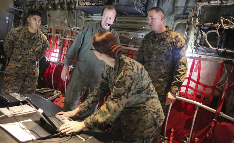 Master Sgt. Michael A. Moore, 3rd Marine Aircraft Wing G-6, technical control engineer, demonstrates the abilities of the Hatch Mounted SATCOM (Satellite Communication) Antenna System (HMSAS) to the commanding general of 3rd MAW, Maj. Gen. Mark Wise aboard Marine Corps Air Station Miramar, Calif., Jan. 9. The HMSAS was developed for pre-deployment training in order to enhance communications for raid force and tactical recovery of aircraft and personnel (TRAP) missions, in preparation to support a Special Purpose Marine Air-Ground Task Force (SPMAGTF).