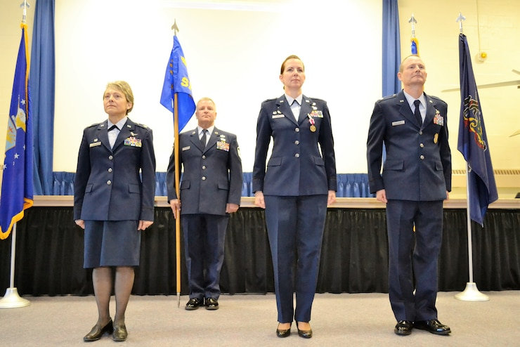 Left to right, Lt. Col. Claudia Malone, 111th Mission Support Group and 112th Cyberspace Operations Squadron commander, 1st Sgt. Brian Zarilla of the 111th Security Forces Squadron, Lt. Col. Christine Munch, 111th Attack Wing inspector general and Lt. Col. James Williams, 111th SFS commander, stand for the assumption of command ceremony at Horsham Air Guard Station, Pa., Jan. 8, 2017. Williams and Munch, who both began their military careers as enlisted security forces Airmen, traded leadership positions during January's regularly scheduled drill (RSD). (U.S. Air National Guard photo by Tech. Sgt. Andria Allmond)