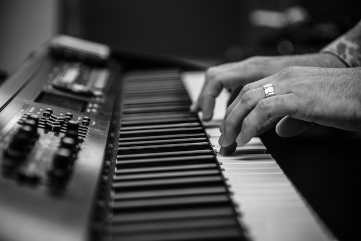 Image of a person playing the keyboard