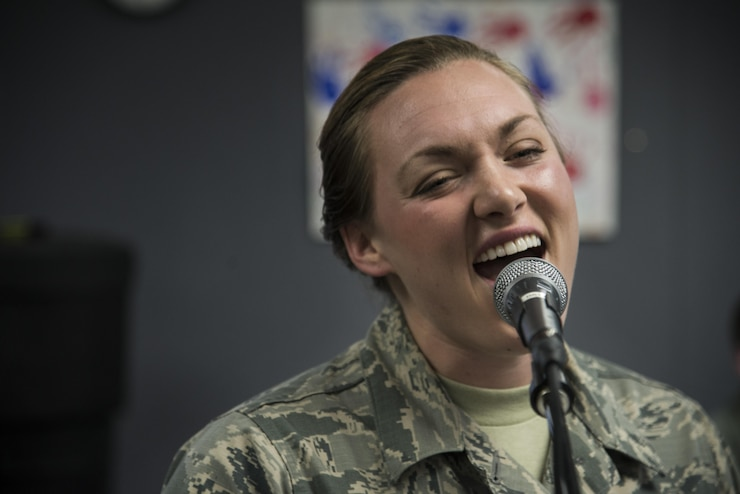 Airman 1st Class Anneke Bentley, Air Force Band of Mid-America Starlifter vocalist, practices in preparation for Scott Air Force bases Centennial Celebration kick off, Jan. 4, 2017 at Scott Air Force Base, Ill. Starlifter is the musical ambassador of the Air Mobility Command. (U.S. Air Force photo by Airman 1st Class Gwendalyn Smith)