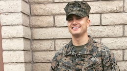 Sgt. Gabriel R. McInnis, engineer equipment mechanic with Bulk Fuel Company C, 6th Engineer Support Battalion, 4th Marine Logistics Group, poses for a photo after receiving a Navy and Marine Corps Achievement Medal at Luke Air Force Base, Ariz., Jan. 7, 2017. McInnis received the medal for his actions in preventing an assault of a family in Tempe, Ariz., Dec. 27, 2016.