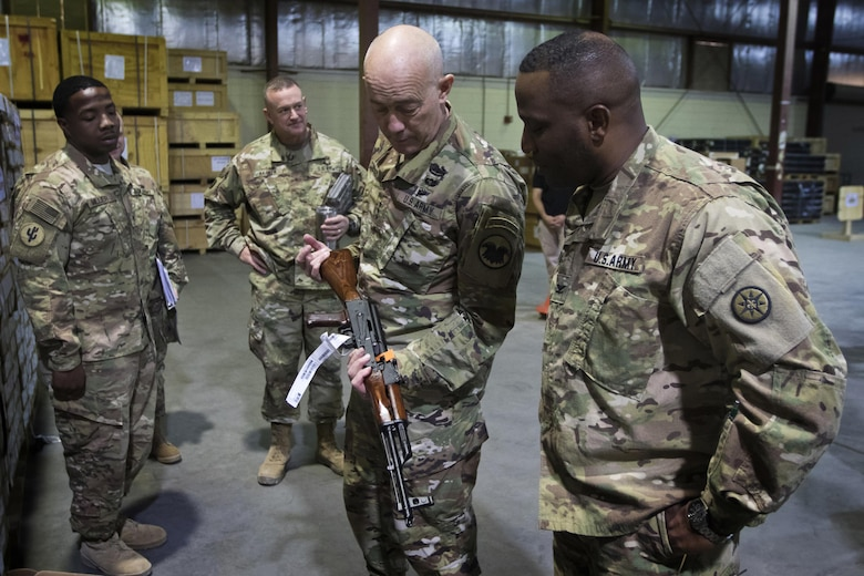 U.S. Army Reserve Commanding General, LTG Charles D. Luckey, inspects an AK-47 rifle during a tour of the Iraq Train and Equipment Fund (ITEF) warehouse at Camp Arifjan, Kuwait, Jan. 4, 2017.