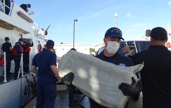 The Coast Guard transferred custody of four suspected smugglers and multiple bales of cocaine to U.S. federal law enforcement authorities at Coast Guard Sector San Juan, Puerto Rico Jan. 8, 2017. In total, 2,000 pounds of cocaine with an estimated wholesale value of $30 million were seized as a result of multi-agency law enforcement efforts in support of Operation Unified Resolve and Operation Caribbean Guard. (U.S. Coast Guard photo)
