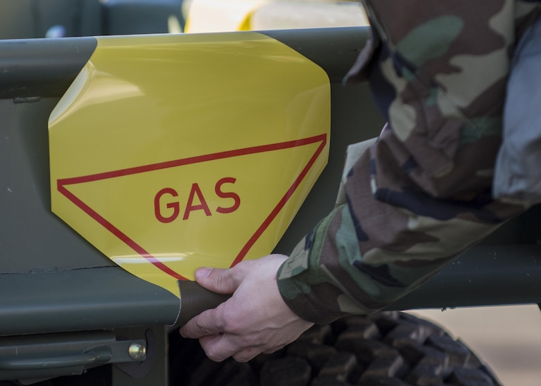 An Airman, participating in an Expeditionary Skills Rodeo event, places a sign on a vehicle at Aviano Air Base, Italy on Jan. 6, 2017. During the event, Airmen participated in 12 different courses which certified them for the next three years. (U.S. Air Force photo by Senior Airman Cory W. Bush)