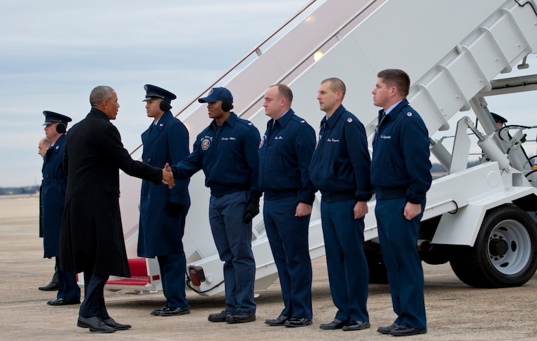 President Barack Obama greets members of the 89th Airlift Wing's Presidential Airlift Group at Joint Base Andrews, Md., Jan. 10, 2017. The president departed for his home city of Chicago to deliver his farewell speech to the nation. (U.S. Air Force photo by Staff Sgt. Joe Yanik)