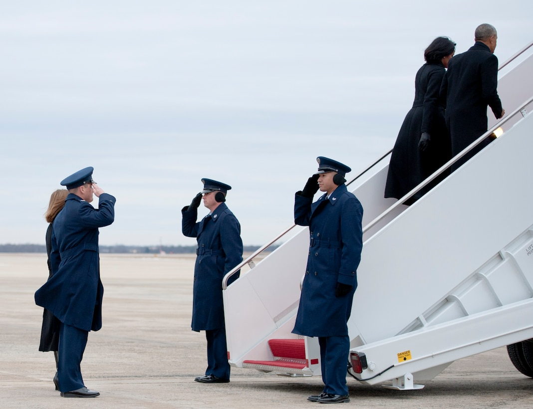 Col. Christopher Thompson (left), 89th Airlift Wing vice commander, salutes President Barack Obama and first lady, Michelle Obama, as they ascend the stairs to Air Force One at Joint Base Andrews, Md., Jan. 10, 2017. The president's next scheduled flight on Air Force One is Jan. 20, Inauguration Day, when his successor, president-elect Donald Trump, takes the oath of office. (U.S. Air Force photo by Staff Sgt. Joe Yanik)