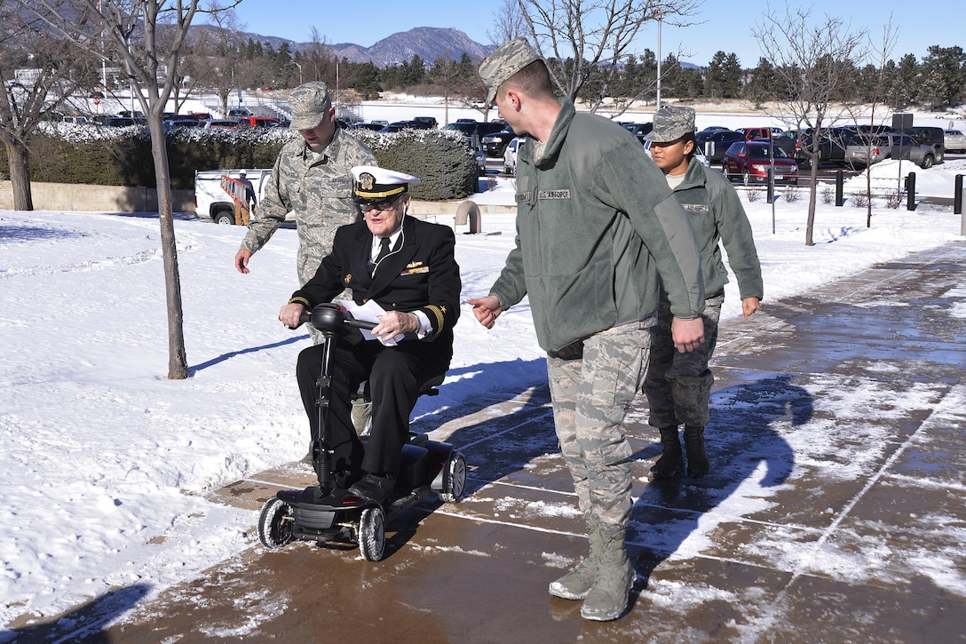 Retired Navy Lt. Jim Downing is escorted by cadet candidates across the U.S. Air Force Academy Preparatory School, Jan. 6, 2017 at the U.S. Air Force Academy. Downing visited the Prep School to share his story of surviving the Dec. 7, 1941 attack on Pearl Harbor by the Imperial Japanese. Downing, 103, is the second oldest-known survivor of the attack. (U.S. Air Force photo/Jason Gutierrez)