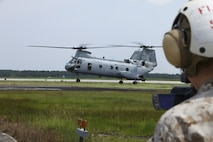 U.S. Marine Corps Sgt. Kathryn K. Bynum, a videographer with 2nd Marine Aircraft Wing Combat Camera, documents the final flight of two CH-46E Sea Knights assigned to Marine Medium Helicopter Squadron (HMM) 774 at the Fleet Readiness Center East, Marine Corps Air Station Cherry Point, N.C., on Aug. 5, 2015. The CH-46E Sea Knights were decommissioned by the U.S. Marine Corps and replaced by the MV-22 Osprey. (U.S. Marine Corps photo by Sgt. Orlando Perez/Released)