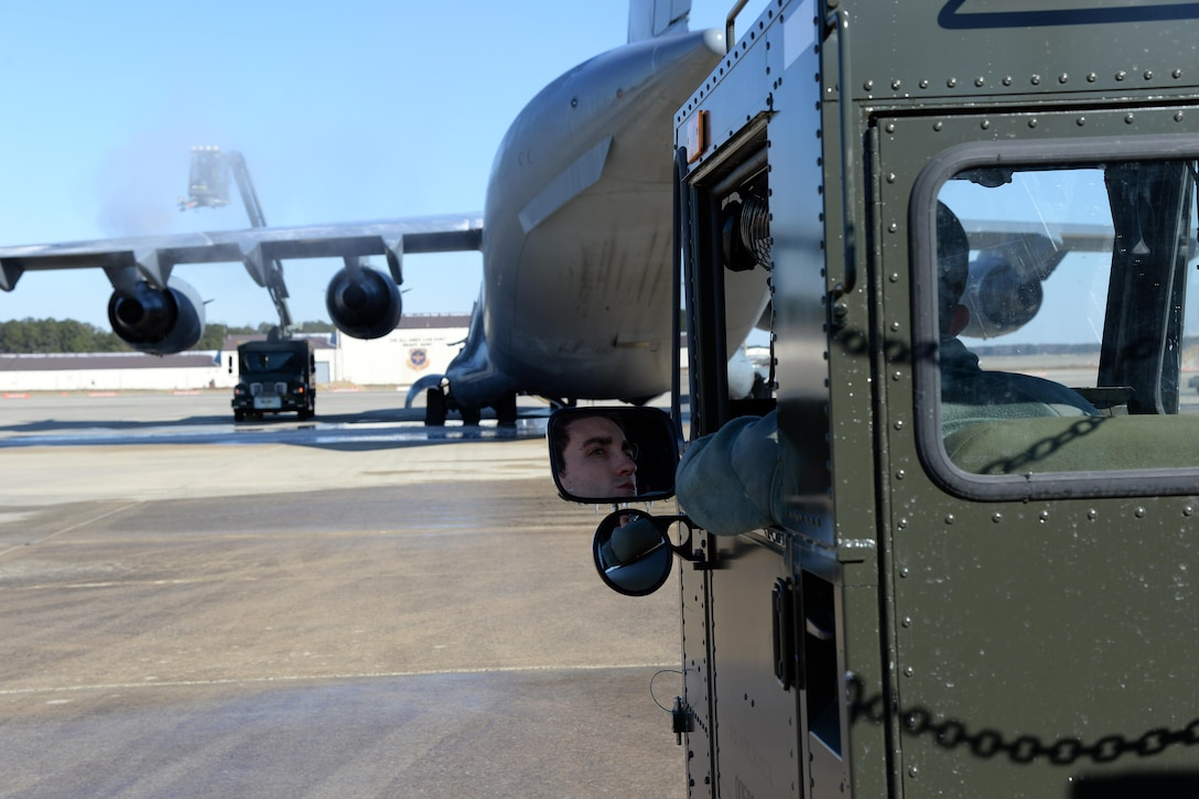 Airman 1st Class Gerard Tembrock, 43rd Air Mobility Squadron porter, waits in a K Loader while members of the 43rd AMS finish de-icing a C-17 Globemaster III on the Pope Army Airfield flightline Jan. 8, 2017. The 43rd Air Mobility Operations Group is responsible for loading cargo and passengers and maintaining transient aircraft operating out of Pope AAF. (U.S. Air Force photo by Master Sgt. Thomas J. Doscher/released)