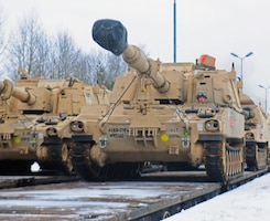 An American soldier from 3rd Battalion, 29th Field Artillery Regiment, 3rd Armored Brigade Combat Team, 4th Infantry Division, drives a M109 Paladin self-propelled howitzer off of a flatcar in Drawsko Pomorskie, Poland, Jan. 9, 2017. The howitzer was one of 53 vehicles that arrived in Northeastern Poland from the Port of Bremerhaven, Germany, as part of Operation Atlantic Resolve. Rotating units through the European theater enhances U.S. European Command's ability to deter aggression and assure U.S. allies. Army photo by Staff Sgt. Corinna Baltos