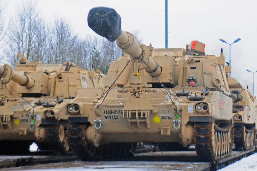 An American soldier drives an M109 Paladin self-propelled howitzer off of a flatcar in Drawsko Pomorskie, Poland, Jan. 9, 2017. The howitzer was one of 53 vehicles that arrived in Northeastern Poland from the Port of Bremerhaven, Germany, as part of Operation Atlantic Resolve. Army photo by Staff Sgt. Corinna Baltos