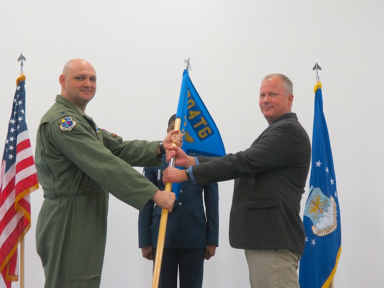 Col. Andrew Allen, commander of the 704th Test Group, appoints the command responsibility of the 704th Test Support Squadron to Eric Lagier during a Change of Responsibility ceremony Dec. 19, 2016, at Holloman Air Force Base, N.M. The 704th TG is an AEDC organization. The 704th TSS oversees operational support to the 704th TG missions which is to operate world-class test facilities for high speed sled track testing, navigation and guidance system testing, radar signature measurements, weapon systems flight testing, and acts as the Air Force liaison for all Air Force programs tested at White Sands Missile Range. (U.S. Air Force photo/Capt. Michael Rodgers)
