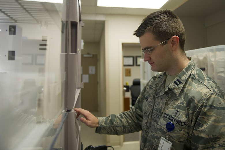 Capt. Kristofer Yaple, chief of pharmacy services for the 1st Special Operations Medical Support Squadron, searches a computer for a prescription at Hurlburt Field, Fla., Jan. 10, 2017. Pharmacists are responsible for dispensing prescribed medications and helping patients understand proper usage and side effects. The nation annually observes Jan. 12 as National Pharmacist Day. (U.S. Air Force photo by Airman 1st Class Joseph Pick)