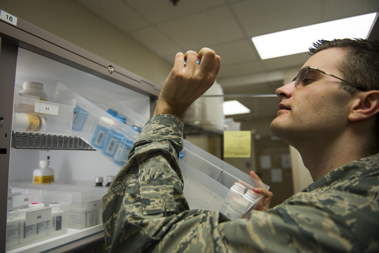 Capt. Kristofer Yaple, chief of pharmacy services for the 1st Special Operations Medical Support Squadron, verifies a medication for a prescription at Hurlburt Field, Fla., Jan. 10, 2017. The 1st SOMDSS typically fills more than 900 prescriptions a day. (U.S. Air Force photo by Airman 1st Class Joseph Pick)