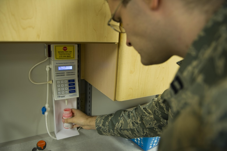 Capt. Kristofer Yaple, chief of pharmacy services for the 1st Special Operations Medical Support Squadron, mixes water with powdered amoxicillin for a prescription at Hurlburt Field, Fla., Jan. 10, 2017. Amoxicillin is an antibiotic that is used to treat different types of bacterial infections. (U.S. Air Force photo by Airman 1st Class Joseph Pick)