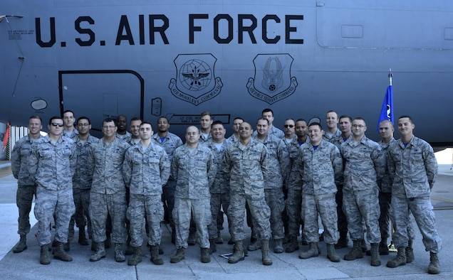 Dedicated crew chiefs (DCC) and assistant DCCs pause for a photo after an induction ceremony at MacDill Air Force Base, Fla., Jan. 6, 2017. The objective of the DCC program is to directly assign a lead maintainer to each aircraft for continuity and accuracy of aircraft forms, status, scheduled maintenance and improve aircraft cosmetics. (U.S. Air Force photo by Senior Airman Tori Schultz)