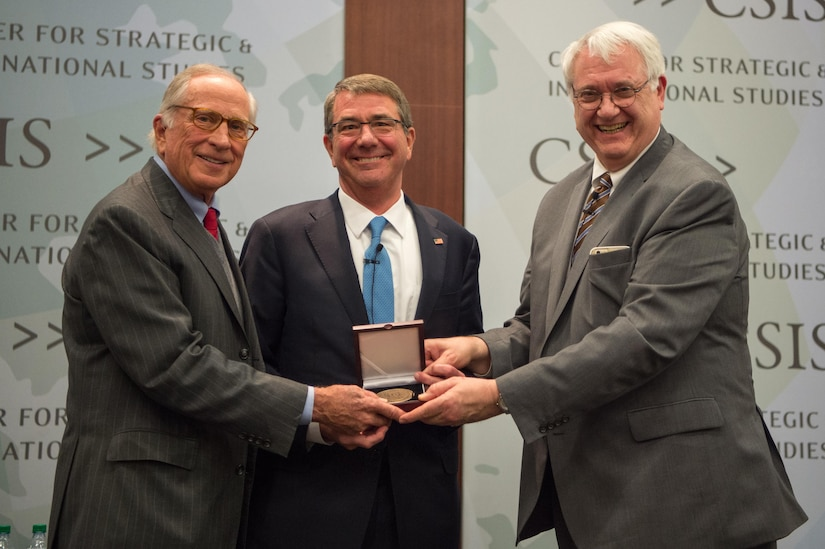 Defense Secretary Ash Carter (center) receives the Sam Nunn National Security Leadership Prize from Sam Nunn (left), former Senator and Chairman Emeritus of the Center for Strategic and International Studies, and John J. Hamre (right), president and CEO of CSIS, in Washington, D.C., Jan. 11, 2017. DOD photo by Army Sgt. Amber I. Smith