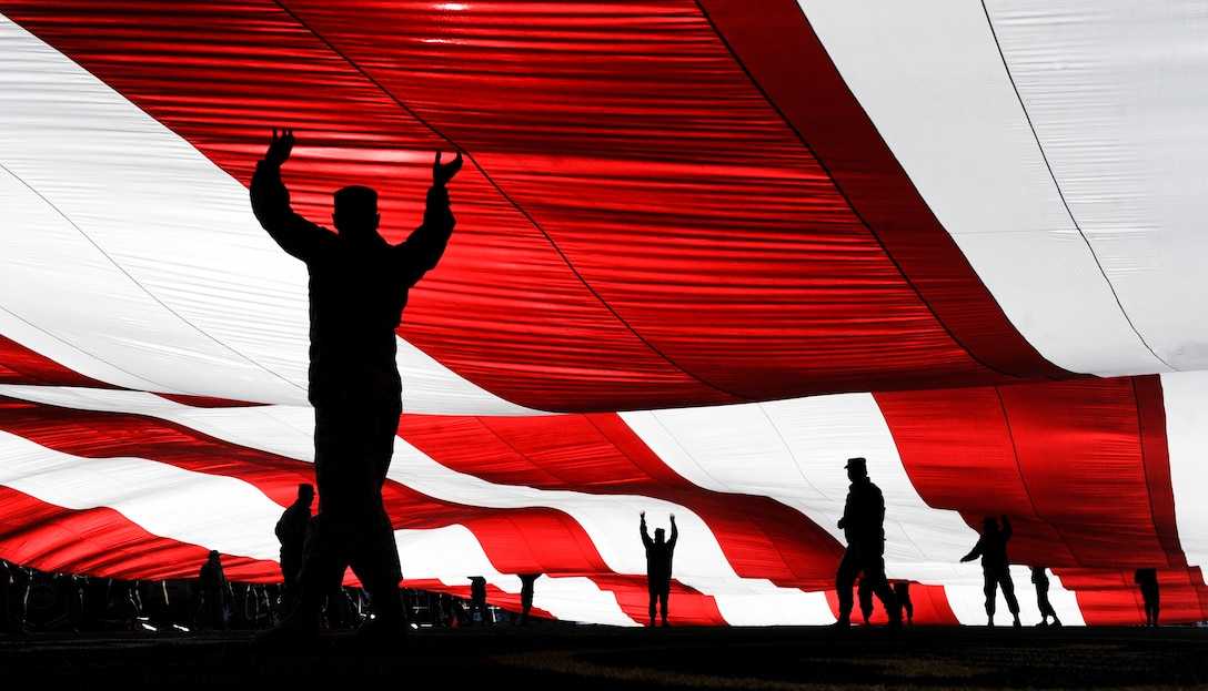 Airmen from Nellis and Creech Air Force Bases in Nevada, hold the American flag at Sam Boyd Stadium before the Las Vegas Bowl Dec. 17, 2016. The 25th Las Vegas Bowl saw Mountain West champion San Diego State rally by scoring 34 unanswered points to defeat Houston, 34-10. (U.S. Air Force photo/Airman 1st Class Kevin Tanenbaum)