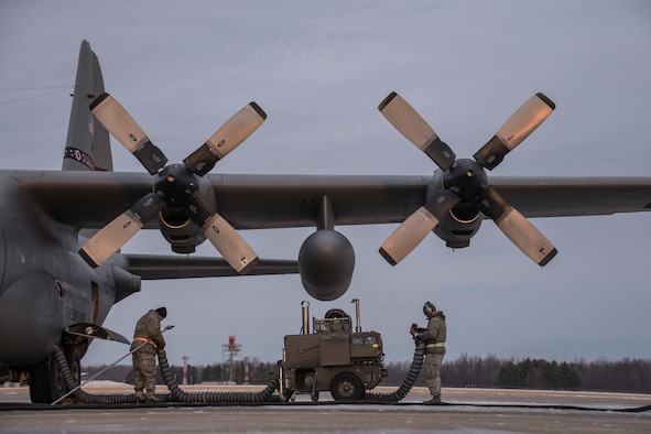 Members of the 179th Airlift Wing Maintenance Group heat the four turbo prop engines of a C-130H Hercules in the cold, early morning Dec. 21, 2016, on the 179th AW flightline in Mansfield, Ohio, as part of daily winter operations. The 179th AW is always on a mission to be the first choice to respond to state and federal missions with a trusted team of Airmen. (U.S. Air National Guard photo/Tech. Sgt. Joe Harwood)
