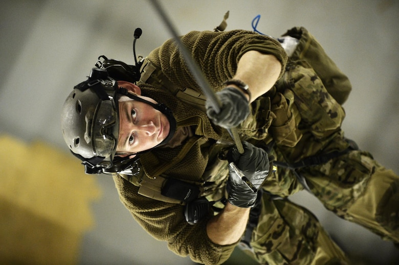 Pararescuemen from the 103rd Rescue Squadron conduct confined space rescue training at Francis S. Gabreski Air National Guard Base in Westhampton Beach, N.Y., Jan. 8, 2017. During this scenario, pararescuemen rappelled from the top of a parachute drying facility to rescue another Airman who had fallen into a confined space. The injured Airman was hoisted to the top of the facility in a litter, and then hoisted back down the outside of the building. (U.S. Air National Guard photo/Staff Sgt. Christopher S. Muncy)