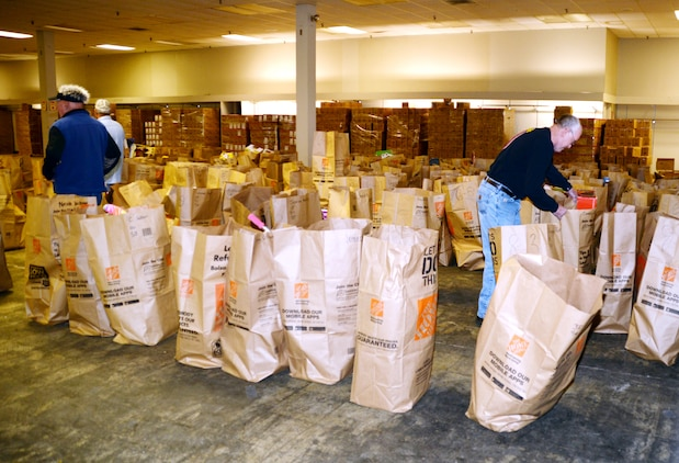 Marine Corps Toys for Tots volunteers sort through bags filled with toys at the Albany, Ga., distribution site Dec. 20, 2016.