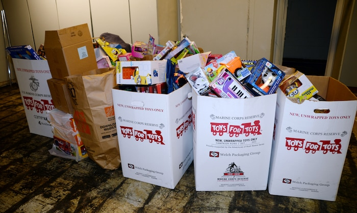 Toys for Tots bins overflow with toys from the local community at the Albany, Ga., distribution site Dec. 20, 2016.