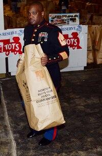 1stSgt. John Horsley, first sergeant, Inspector-Instructor, Detachment 2, Supply Company, Combat Logistics Battalion-453, Combat Logistics Regiment-4, helps distribute toys in Albany, Ga., Dec. 20, 2016.
