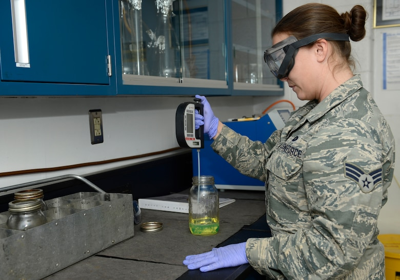 U.S. Air Force Senior Airman Brittany Litton, 733rd Logistics Readiness Squadron fuels laboratory technician, tests the quality of diesel fuel at Joint Base Langley-Eustis, Va., Jan. 6, 2017. The laboratory uses multiple tests and equipment to ensure the highest quality product is provided to the 1st Fighter Wing and their mission partners. (U.S. Air Force photo by Airman 1st Class Kaylee Dubois)