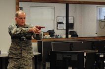 """Master Sergeant Steven Shiflett, 916th Air Refueling Wing inspections superintendent simulates an """"active shooter"""" during an exercise on Jan. 11, 2017, at Seymour Johnson Air Force Base, North Carolina. (U.S. Air Force photo by Senior Airman Jeramy Moore.)"""