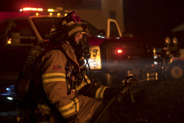 Staff Sgt. Joshua Humes, 23d Civil Engineer Squadron fire protection crew chief, kneels during nighttime, live-fire training, Jan. 10, 2017, at Moody Air Force Base, Ga. Approximately 15 firefighters participated in this live fire training. (U.S. Air Force photo by Airman 1st Class Daniel Snider)